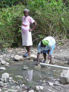 Women in Baille Touribe gather water from an area stream. Photo by Heikki Ketola