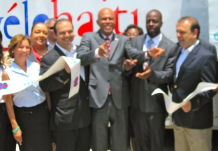 President Michel Martelly cutting ribbon at CT Scanner dedication ceremony